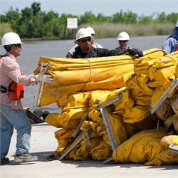 Workers Prep Booms to Protect Shoreline