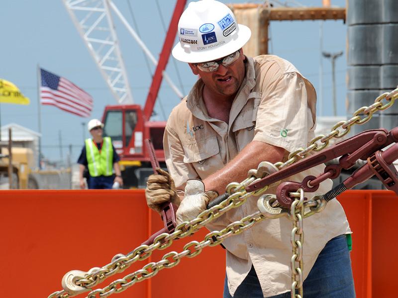 A crewman aboard secures a cofferdam