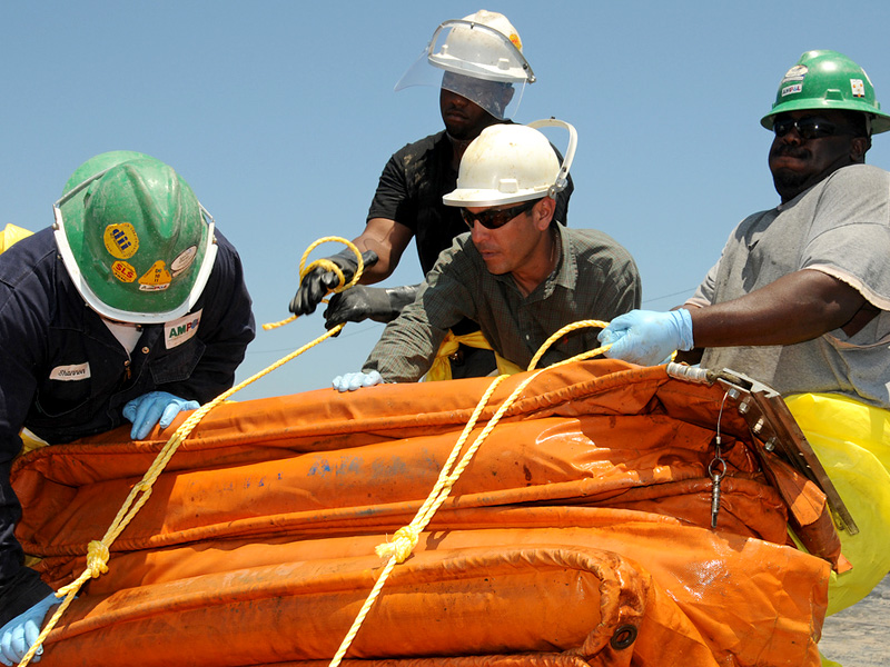 Workers Bundle Oil Containment Boom